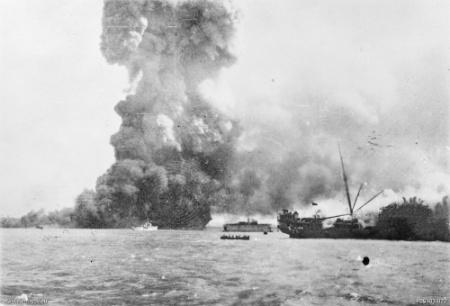 MV Neptuna exploding at Stokes Hill Wharf