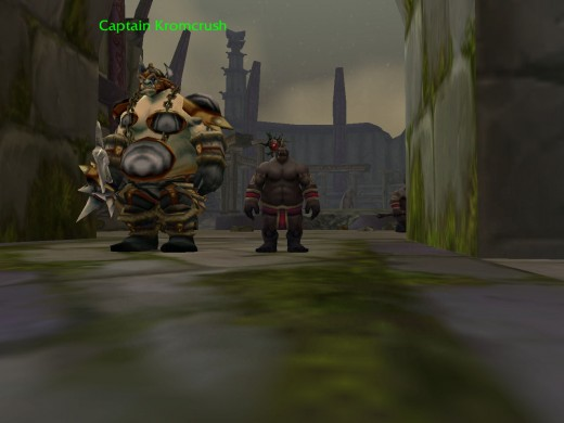 Captain Kromcrush side by side with a player disguised in the gordok ogre suit.