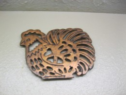 An old copper trivet.