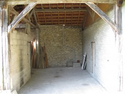 Camille's garage wall (right) and open barn restored as near to original as possible