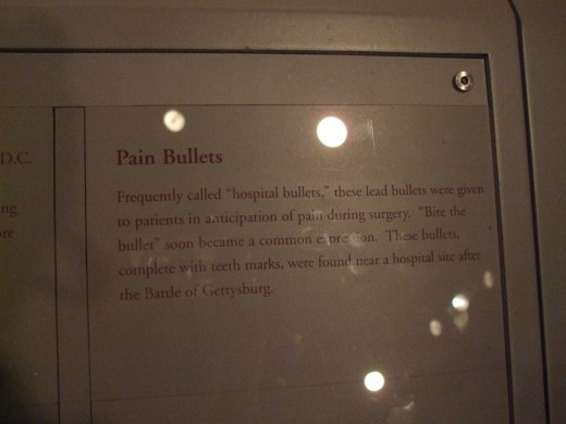 "Explanation of the expression ""bite the bullet"" which comes from the use of bullets by patients in surgery."