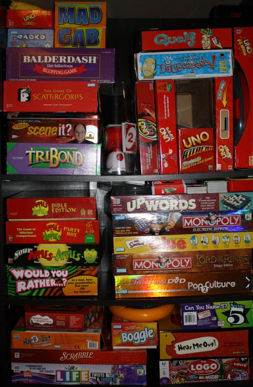 My collection of board games (excluding the dominoes and Mexican Train dominoes that were too heavy for the shelves). I admit I may have a small problem.