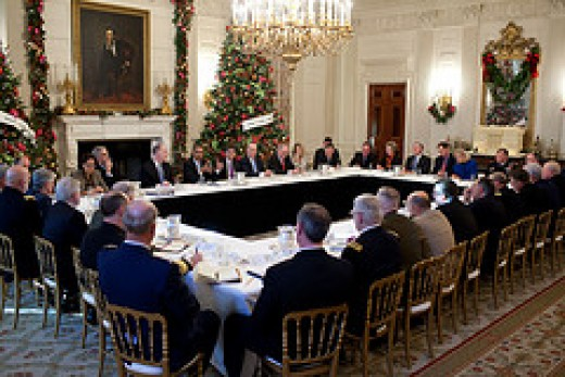 President Obama meets with his Cabinet and Special Advisors to discuss an important issue that will affect us, the citizens of the United States. I don't see any coffee on this table.