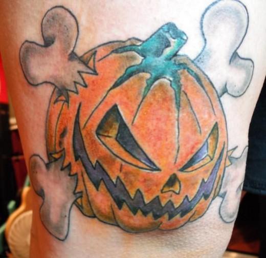 Evil pumpkin tattoos hubpages for Tattoos of pumpkins