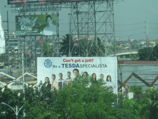 EDSA billboards and tarpaulins near Balintawak LRT station