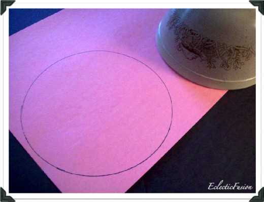 Trace a circle onto construction paper.