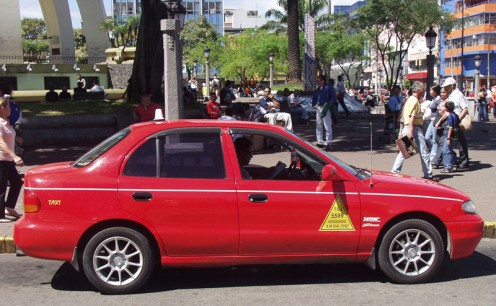 A common red taxi in Costa Rica