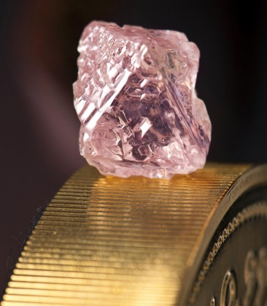 This photo, released by mining giant Rio Tinto shows a 12.76 carat pink diamond, largest ever found in Australia.