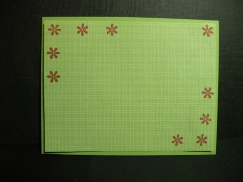 Background adhered to card and stamped