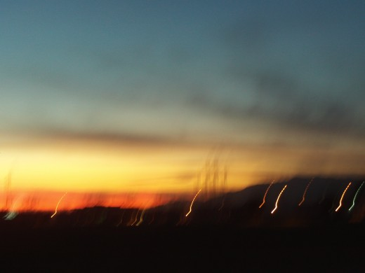 The lights blur to create an interesting effect in this sunset photograph.