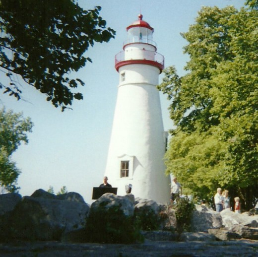 Adventurous visitors to Marblehead Lighthouse State Park in Ohio take a closer look at the rocky shoreline that presents a danger to man and ships.