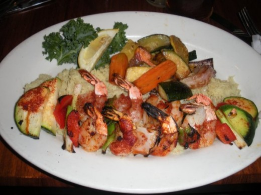 This shrimp dish with rice and vegetables at Claim Jumper ran $15.99. Would it have cost more to make at home?