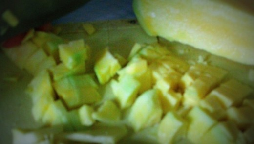 Chop the mango depending upon you preference.  I still want to munch its sourness so we will chop it into cubes...