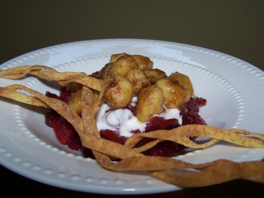 Gnocchi Bathed in Muscovado Sugar and Cinnamon Served over a Cranberry Compote with Vanilla Cream and Crispy Fettuccine