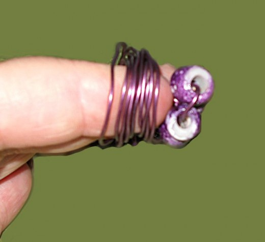 twist wire around fingers as shown but reserve several inches