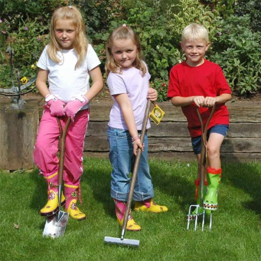 kids with gardening tools
