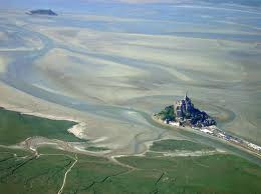 Aerial view of Mont St Michel shows the coast around the monastery at low tide. There would be widespread quicksands in the area. This is where Harold rescued one of William's men from a slow death