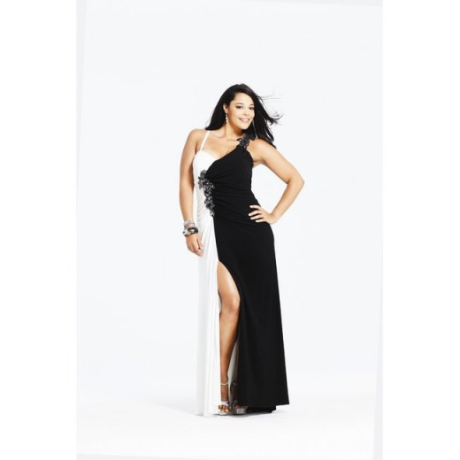 This black and white sheath is perfect to show off your legs. The asymmetrical neckline will draw attention away from big arms, and the white side of this dress almost disappears, making you look half your size. Available up to size 24