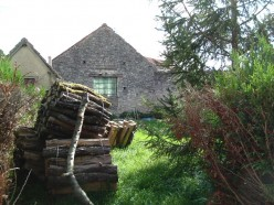 Gable end of old sawmill protecting neighbour's garden