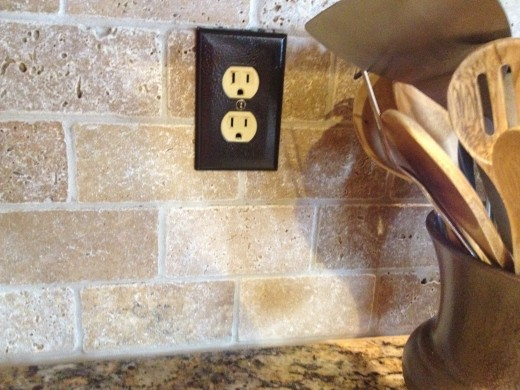 tile and painted outlet cover