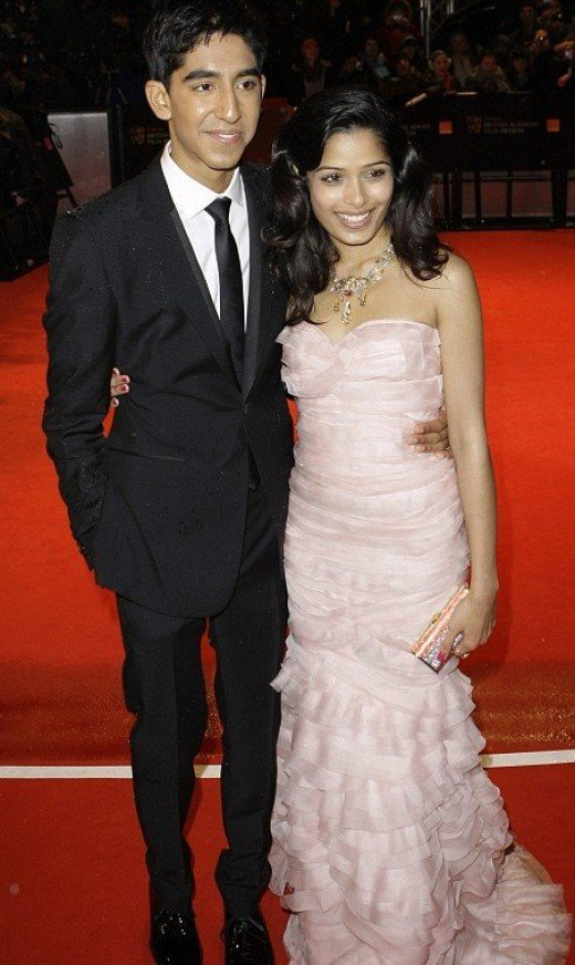 Freida Pinto and Dev Patel attend an awards function.
