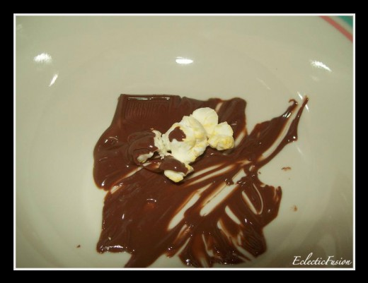 One of my favorite snacks. Buttered popcorn dipped in melted Hershey's chocolate! :drool: