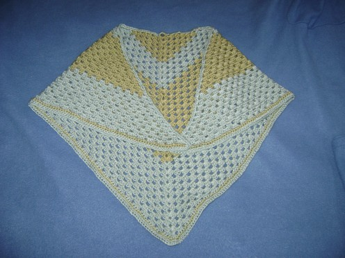 A half-granny square makes a simple crocheted shawl