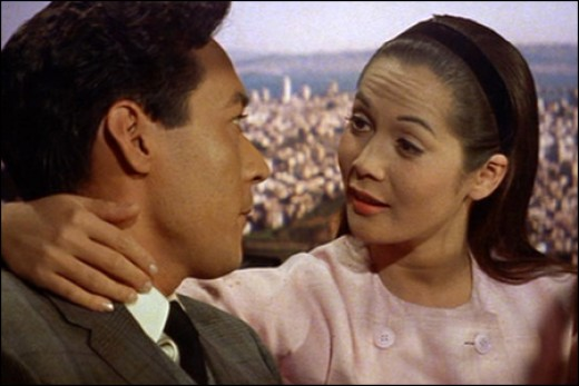 "Nancy Kwan and James Shigeta in a scene from ""Flower Drum Song"""