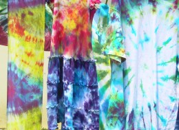 Tie-dyed clothing drying in the soft breezes and sunshine of a summer's day