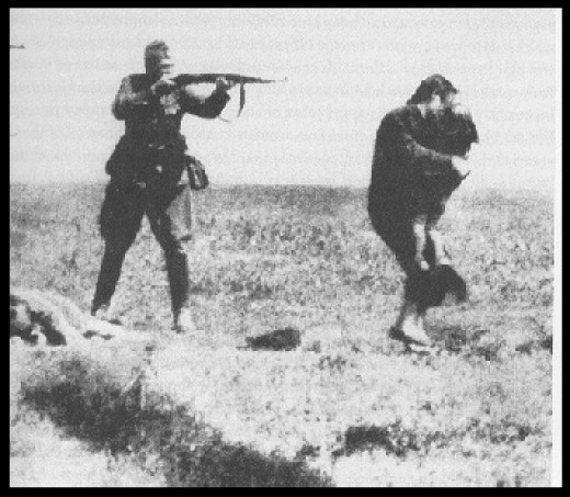 Einsatzgruppen execution of a woman and child in Ukraine.
