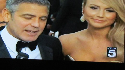 George Clooney on the red carpet with his date before the Oscars.