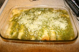 Pour sauce over the enchiladas to cover the tortilla rolls and sprinkle cheese on top. Bake at 350F for 20 minutes.