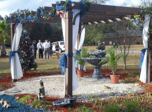 """The arbor was lovely for the """"back yard"""" wedding."""