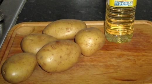 Peel the potatoes, wash and cut them