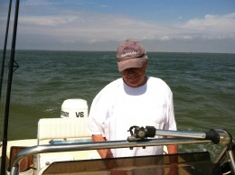 Captain at the Wheel checking the GPS and ocean Floor