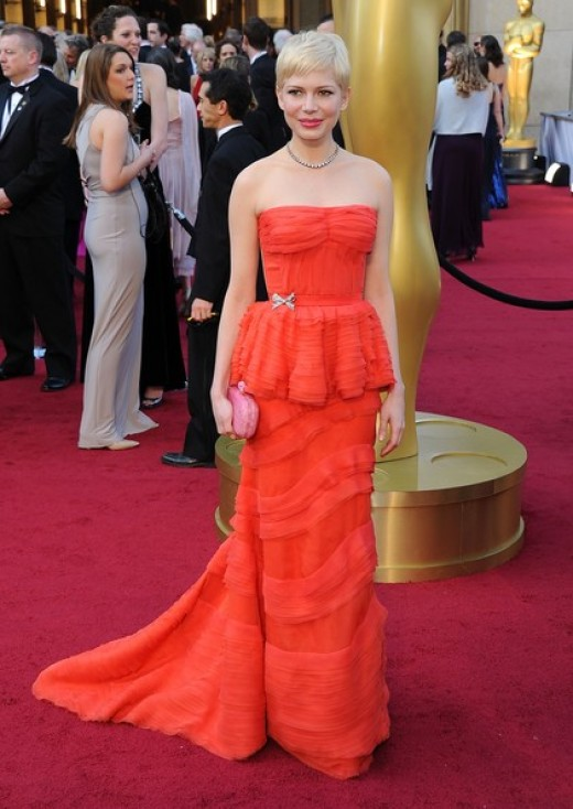 Michelle Williams at the 84th Annual Academy Awards. She called the color of her dress coral.