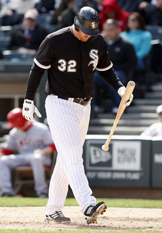 Adam Dunn takes one of his many walks back to the dugout in the 2011 season.