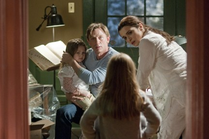 "Craig and Weisz have a family moment in ""Dream House."""