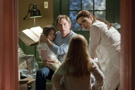 """Craig and Weisz have a family moment in """"Dream House."""""""