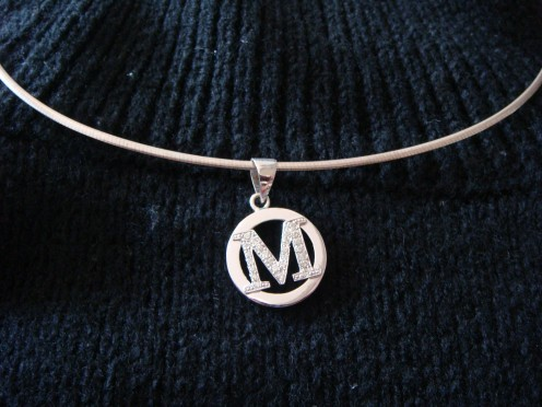 Personalized pendant bearing the first letter of my name.