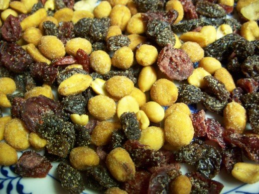 Closeup of honey-roasted peanuts, raisins, dried cherries and dried cranberries