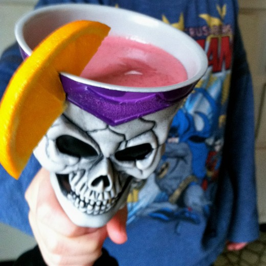 William's smoothie served in a skull goblet and garnished with an orange slice