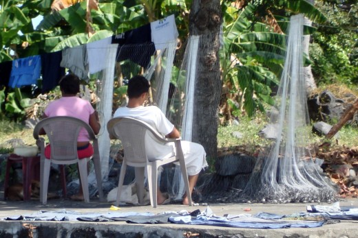 Fishermen repairing nets.