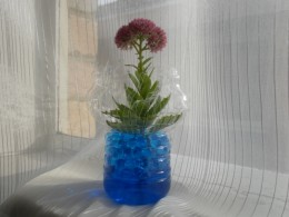 A clear plastic vase is stunning too.