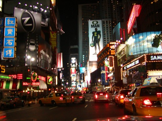 another night picure taken from the drivers seat of my limo, approaching Times Square   © Eric Heifetz