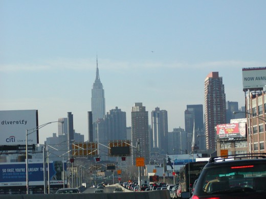 taken while driving ( stopped & no passengers ) ) into NYC on the BQE approaching the Midtown Tunnel, with the Empire State Building in the background   © Eric Heifetz