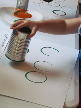 Painting with tin cans.  There are many everyday objects that make great preschool painting tools.