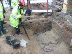 Archaeological photographer and horse burial in re-cut ditch