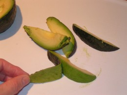 This image demonstrates an easy way to peel an avocado.