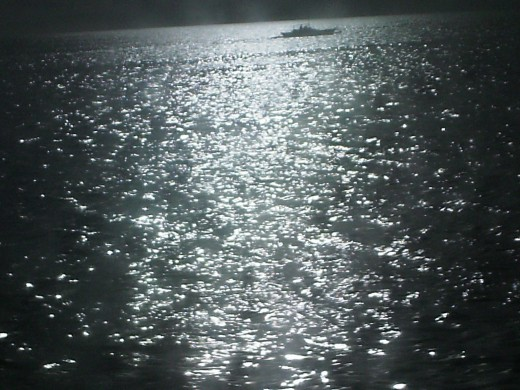 Rays of the setting sun reflected on a calm sea
